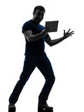 Man holding watching  digital tablet  silhouette Royalty Free Stock Photos