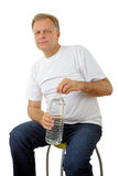 Man holding a water bottle Stock Images