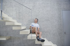 Man Holding Water Bottle On Steps Stock Photography