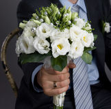 Man holding a wedding bouquet Royalty Free Stock Photo