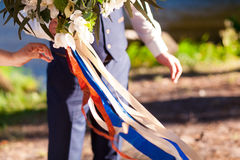 Man holding wedding bouquet, colored ribbon Royalty Free Stock Photos