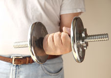 Man holding weight Royalty Free Stock Image