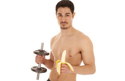 Man holding weight and banana Royalty Free Stock Images