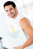 Man holding a weight scale Stock Image