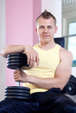 Man holding weights Royalty Free Stock Image