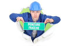 Man holding wet paint sign Royalty Free Stock Images