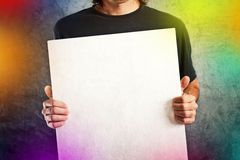 Man holding white banner Royalty Free Stock Photography