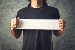 Man holding white banner Stock Images
