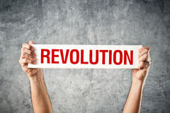 Man holding white banner with revolution title Royalty Free Stock Photo