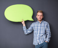 Man holding white blank speech bubble with space Royalty Free Stock Photo