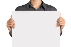Man holding white board. Man holding a blank white board in front of his chest Royalty Free Stock Photography