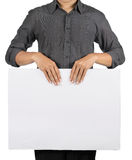 Man holding white board. Man holding a blank white board in front of his chest Stock Photos