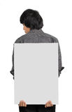 Man holding white board Stock Images