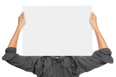 Man holding white board. Man holding a blank white board on top of his shoulder Royalty Free Stock Photography