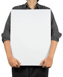 Man holding white board. Man holding a blank white board in front of his chest Stock Images