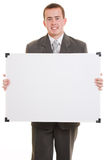 Man holding a white board. Businessman with a white board in his hands on a white background Royalty Free Stock Photography