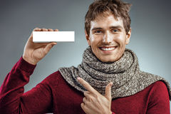 Man holding white box of medicine and pointing finger. Stock Photos