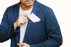 Man holding white business card. Man wearing blue shirt and showing blank white business card. Blurred background. Horizontal mockup, Smart asian business Stock Photography