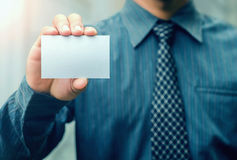 Man holding white business card. And sunshine Stock Images