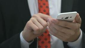 Man holding the white cellphone indoors stock footage