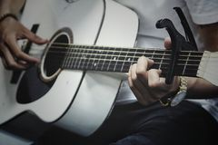Man Holding a White Dreadnought Acoustic Guitar Royalty Free Stock Images