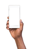 Man holding white mobile smart phone with blank screen Stock Images