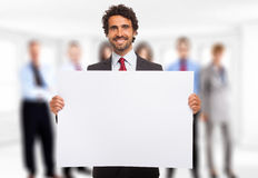 Man holding a white panel Royalty Free Stock Photos