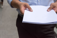 Man holding white paper documents Royalty Free Stock Photos