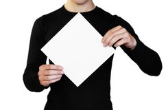 A man holding a white sheet of paper. Holding a booklet. Close up. Isolated on white background.  royalty free stock images