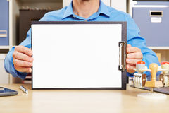 Man holding white sheet of paper on clipboard Royalty Free Stock Photo