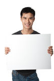 Man holding white sign. While standing on white background Royalty Free Stock Images