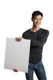 Man holding white sign Stock Photos