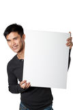 Man holding white sign. While standing on white background Royalty Free Stock Photo