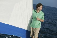 Man Holding Wine Glass On The Sailboat Royalty Free Stock Image
