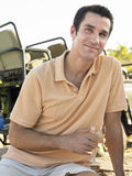 Man Holding Wineglass With Jeep In Background Royalty Free Stock Photography