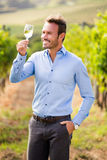 Man holding wineglass Stock Images