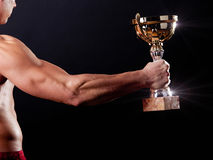 Man holding winning cup Royalty Free Stock Photography