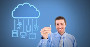 Man holding wire connection with cloud devices. Digital composite of Man holding wire connection with cloud devices stock image