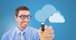 Man holding wire connection with clouds. Digital composite of Man holding wire connection with clouds Stock Image