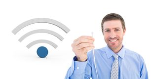 Man holding wire connection with wi-fi icon. Digital composite of Man holding wire connection with wi-fi icon Stock Photos
