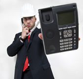 Man holding wired phone Stock Image