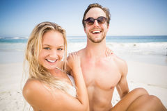 Man holding woman in his arms on the beach Royalty Free Stock Photo