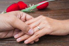 Man holding woman's hand with a ring Stock Images