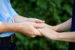 Man holding a woman's hands Stock Photography