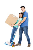 Man holding woman standing on luggage trolley Royalty Free Stock Images