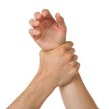 Man holding woman by wrist Royalty Free Stock Photography