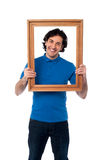 Man holding wooden picture frame Stock Photography
