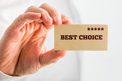 Man holding a wooden rectangle saying Best Choice Royalty Free Stock Image