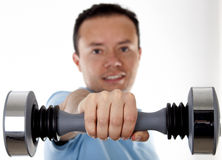 Man holding workout weight. Royalty Free Stock Photography