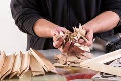 Man holding workpieces of framework Stock Photography